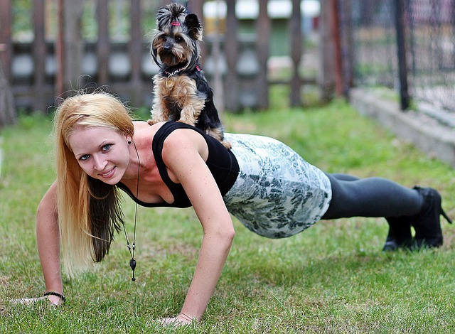 blonde woman, yorkie, dog
